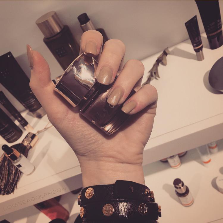 beige nail polish tory burch bracelet